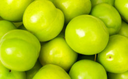 Green apples arranged on the market stand